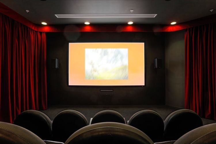 Cinema inside AMC's London office fit out