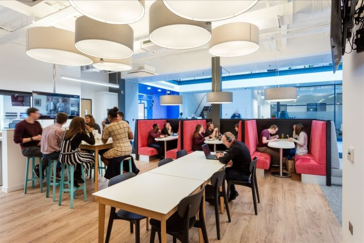 Staff eating in an office cafe with high stools