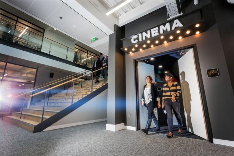 People walking out of a Cinema door