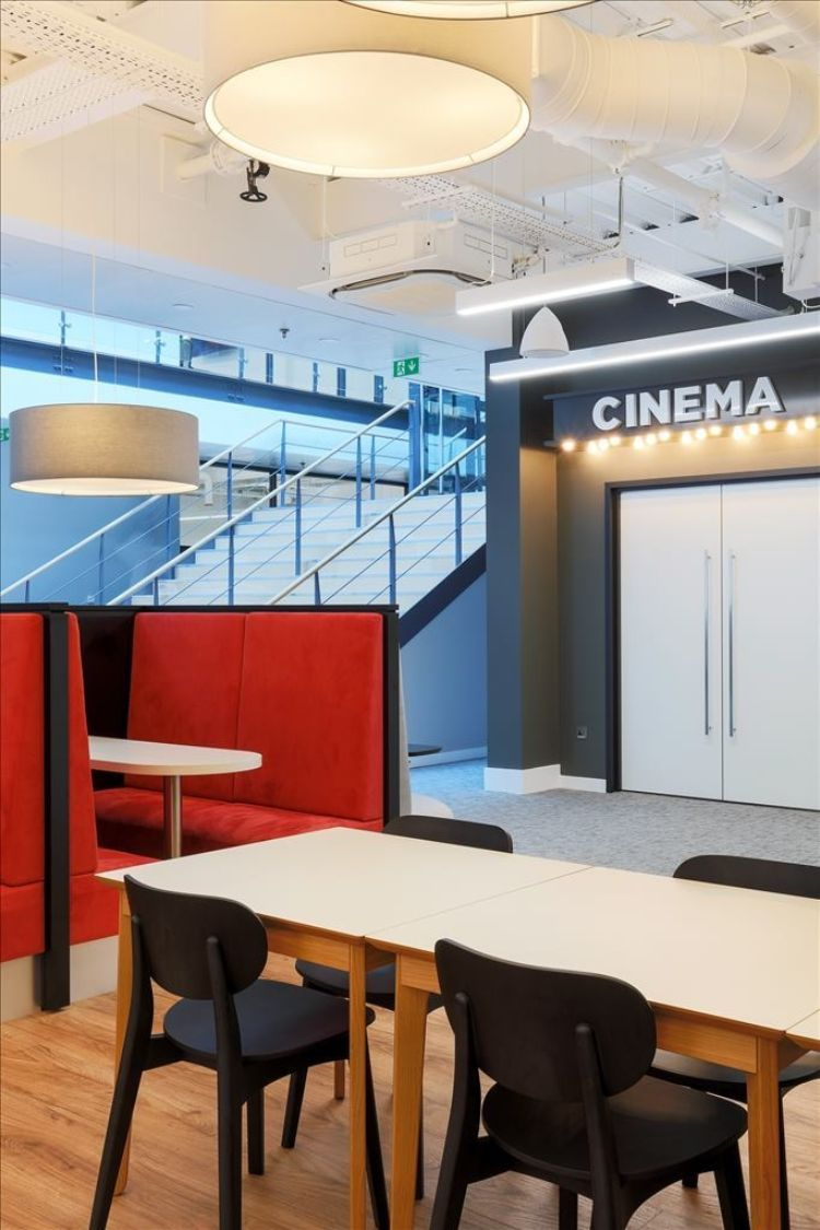 View of on-site cinema in AMC's new office fit out