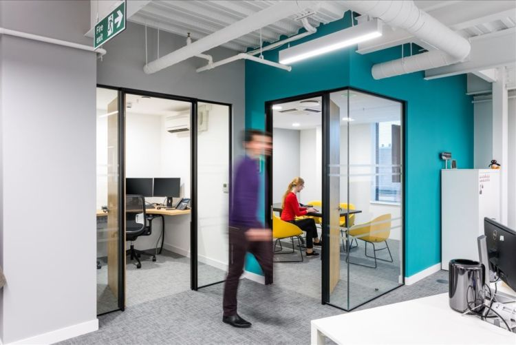 Meeting rooms seen from an open plan office floor
