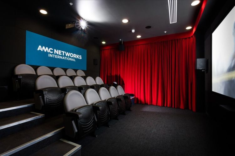 Cosy cinema with red drape curtains in the AMC Networks office