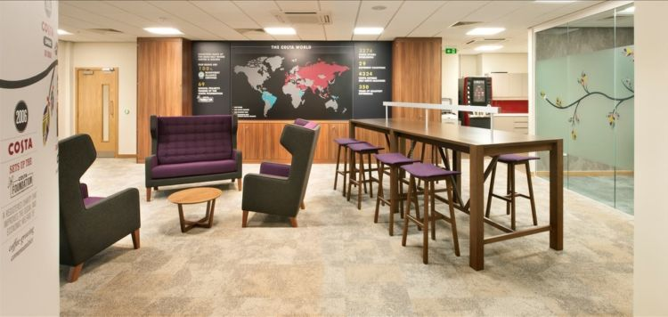 Purple lounges and standing meeting area in a modern office deisgn