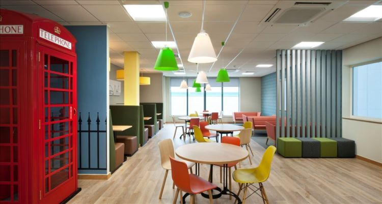 Funky office breakout area with british phone box and coloured seating
