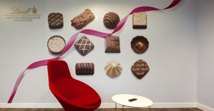 Chocolate wall decal and red chair in the Lindt office in Feltham