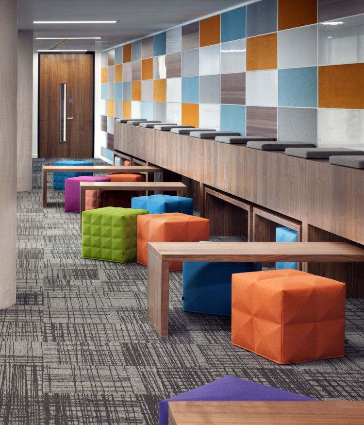 Coloured wall paneling and ottomans in modern Cardiff office