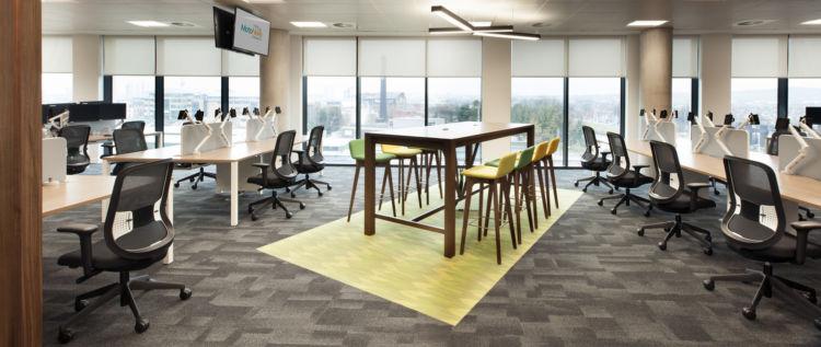 Standing desk area inbetween conventional office workstations