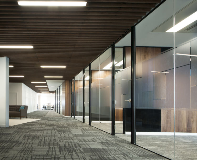 Wooden ceiling panels and open plan meeting rooms