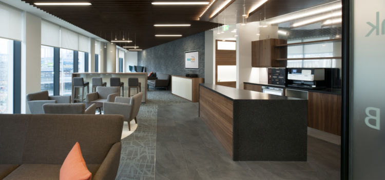 Staff breakout area and kitchen with wooden paneling