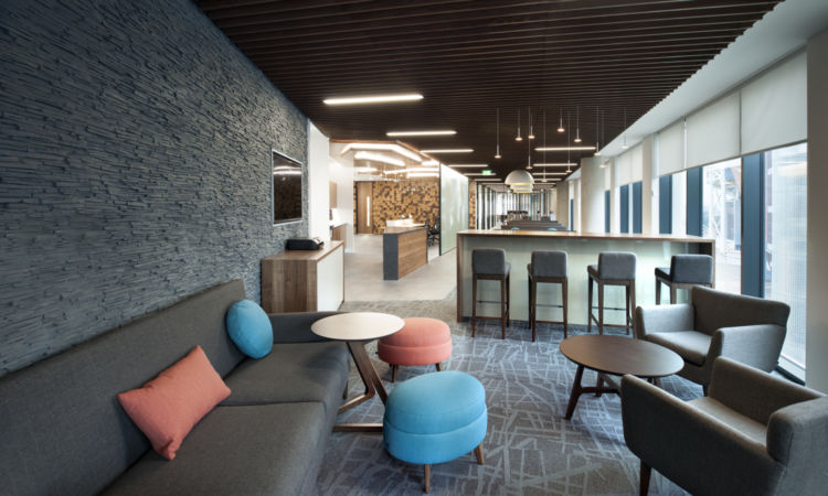 Client area with slate walls in cool office design
