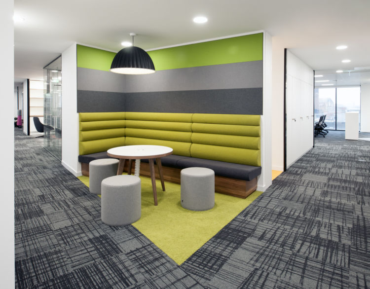 Corner meeting area with comfy furnishings