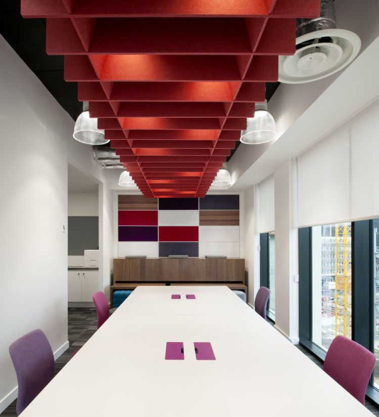 Coloured boardroom table with accentuated chairs