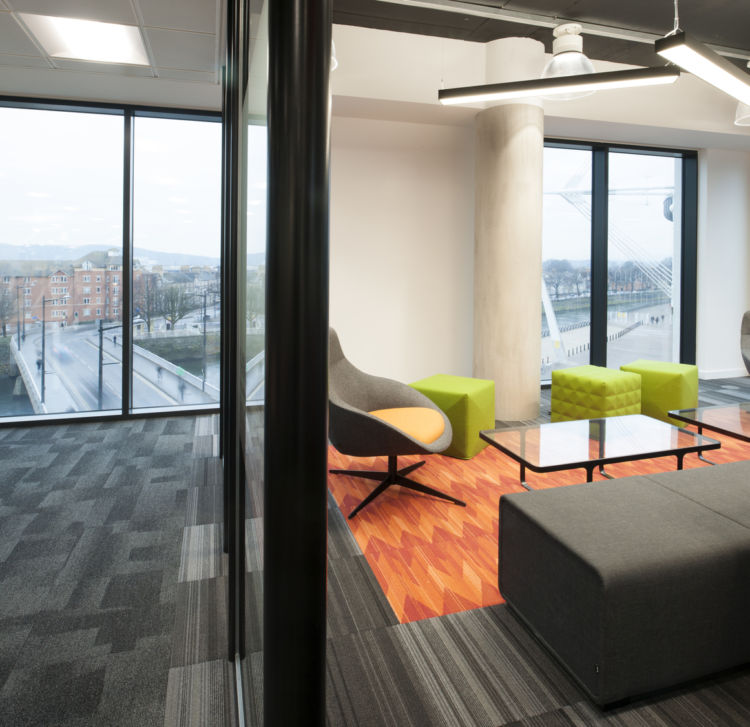 Meeting room with bright carpet and mixed seating