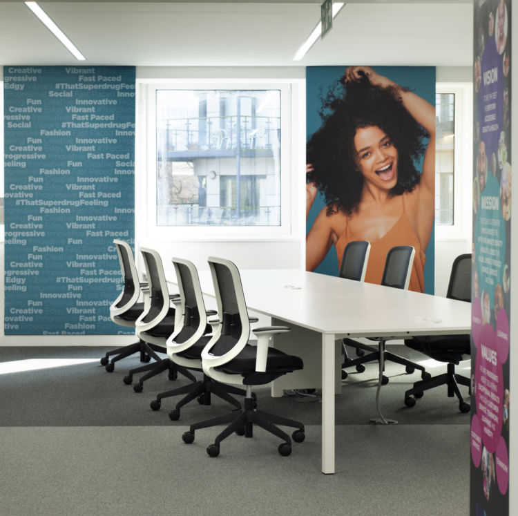 Bright meeting room with photo wall prints