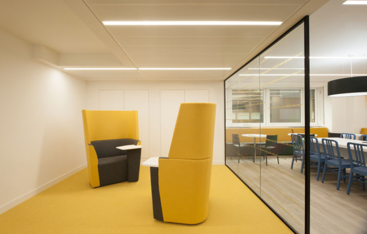 Bright yellow meeting room with matching carpet and flooring