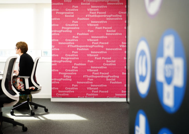 Pink office wall prints with company values