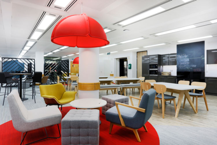 Relaxing chairs under a red light in this central London office fit out