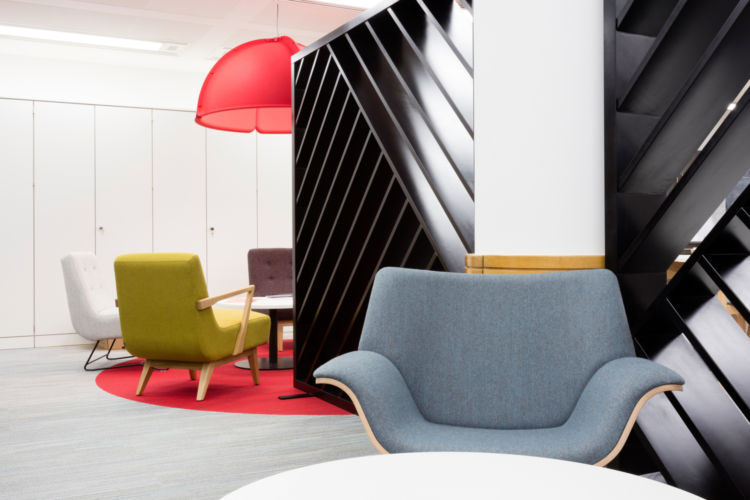 A mix of seating options allows staff to collaborate in this London office design