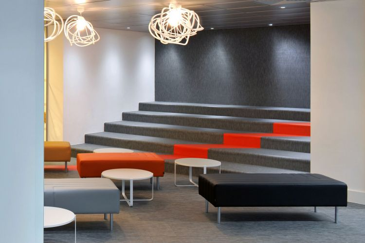 Tiered bleacher style seating in the British Librarby / Office Design by Morgan Lovell