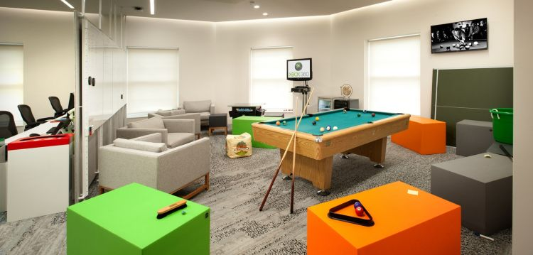 Staff breakout area with pool table and coloured ottomans in funky office fit out