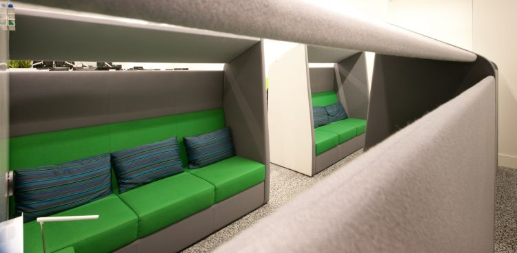Green pod chairs in modern office fit out