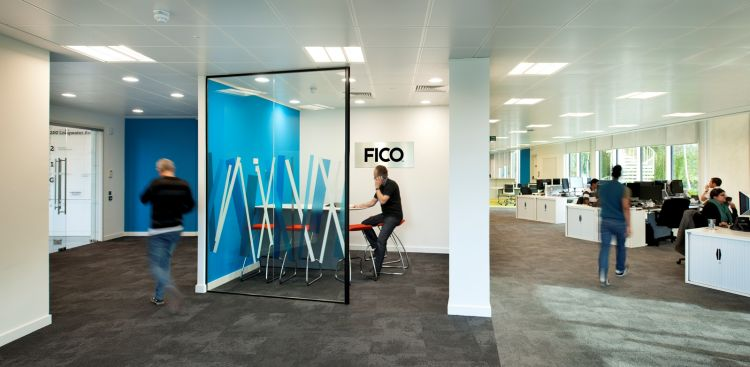 View of semi-private meeting space in open plan office fit out