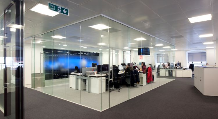 Glass walled dividers separate different teams