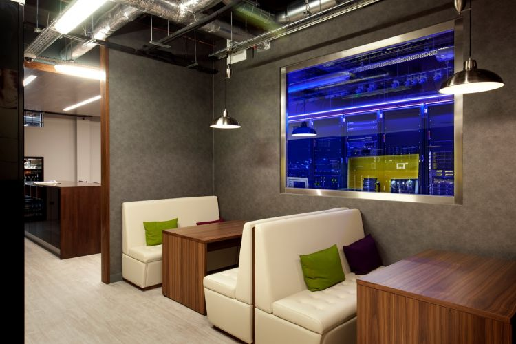 Relaxed staff kitchen with grey walls and wooden features in modern office fit out