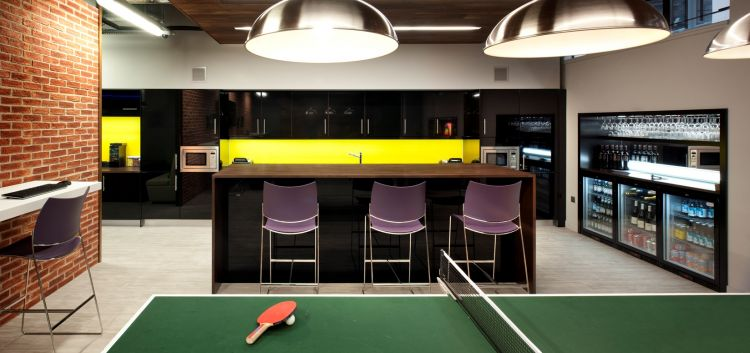 Modern office kitchen and bar with ping pong table