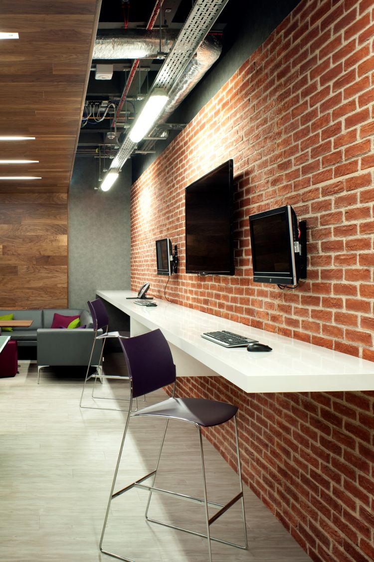 Exposed brick walls add a loft feeling to this modern office