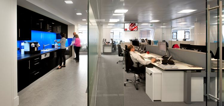 View showing modern kitchen and insulated offices in otherwise open plan floor space