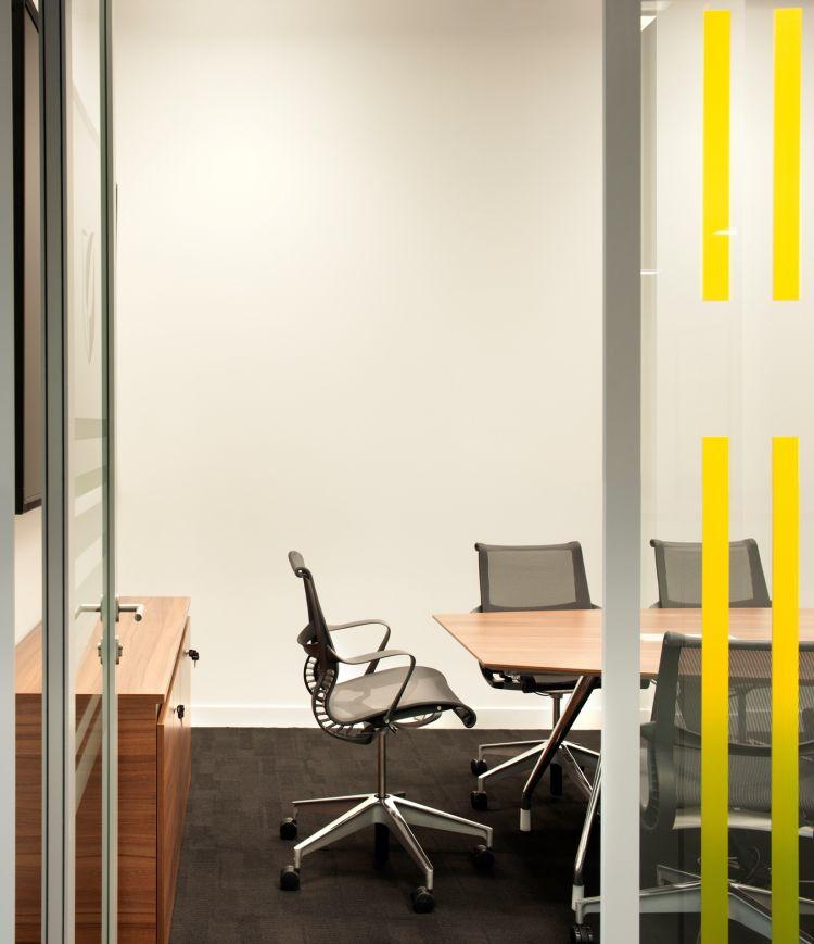 Looking through a door into a modern meeting room