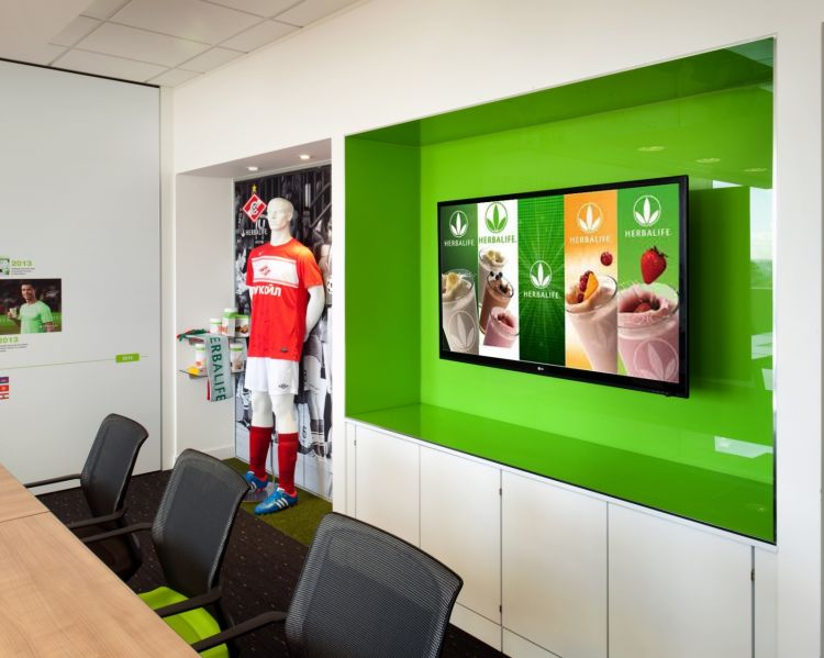 Meeting room with large tv showing products and smoothies
