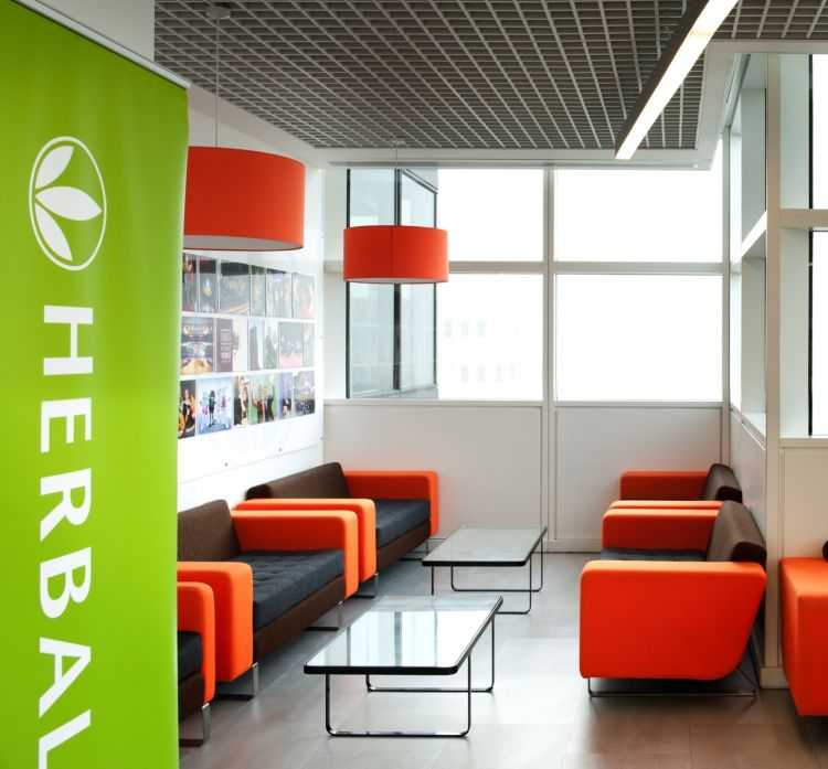 Orange designer furniture and tables in modern office interior