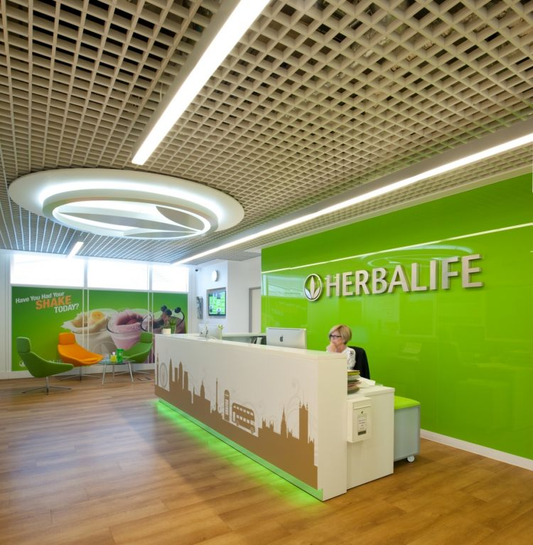 Herbalife corporate reception with green backdrop  in new office fit out