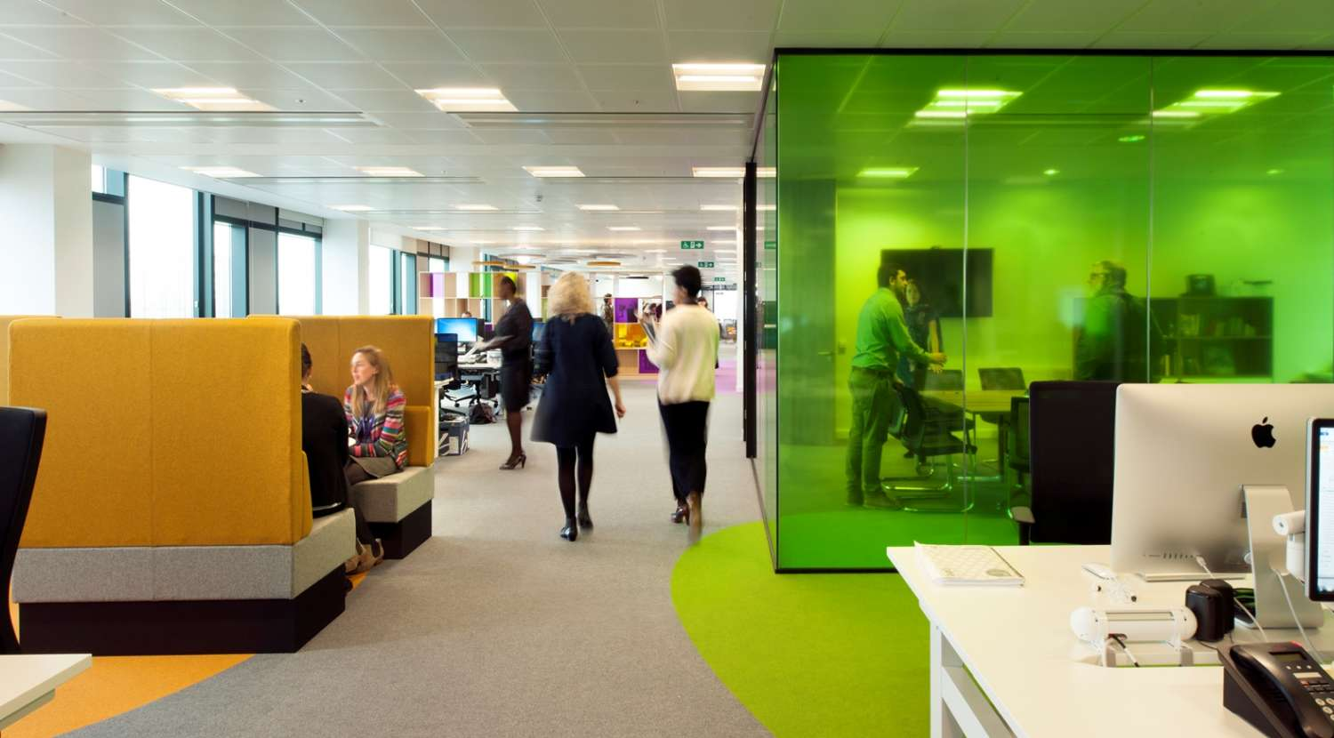 Yellow private pods and a green meeting room in the office fit out for Livability