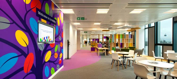 Colourful interactive wall and pink floor detailing in the office design for Livability