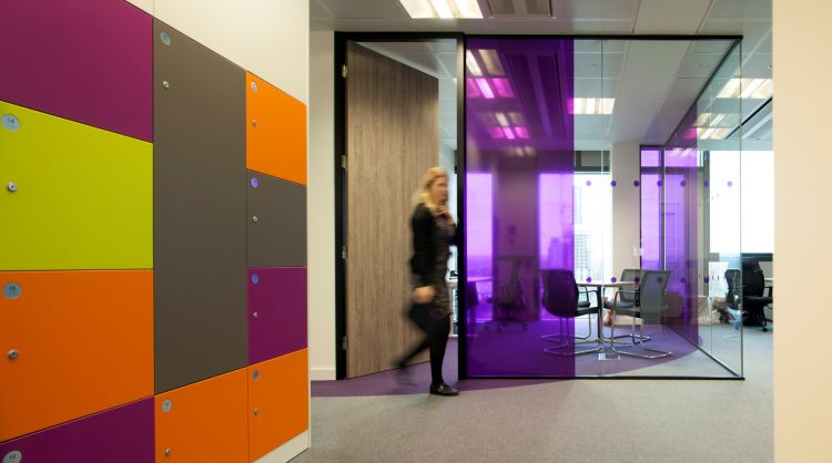 Coloured glass panels help identify each meeting room in the office design for Livability