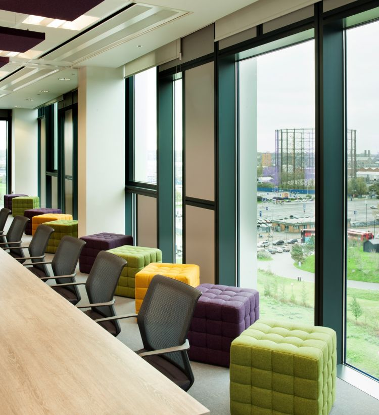 Additional ottoman seating in the Livability boardroom