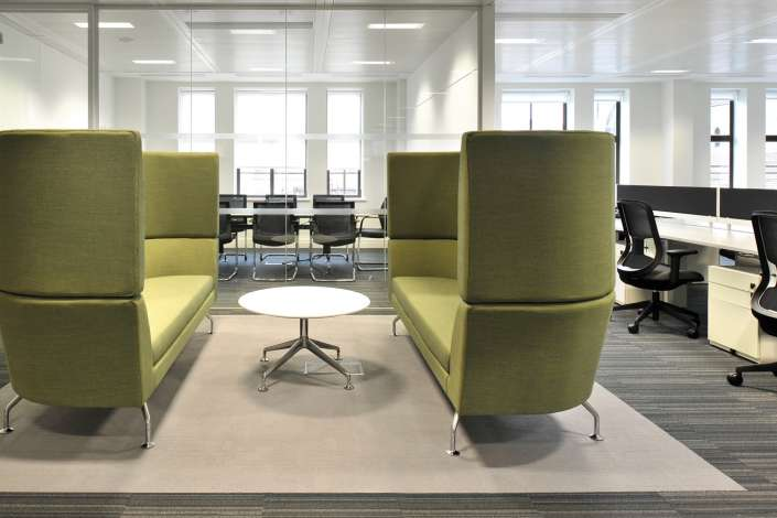 Semi-private meeting pods with high backs in an open plan office