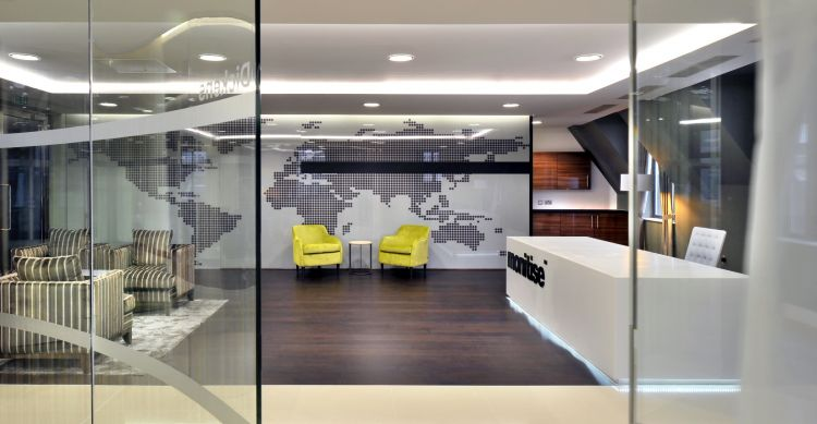 Map of the globe and wooden floors highlight this designer office reception