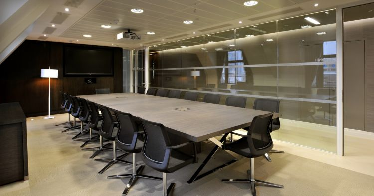 Large corporate boardroom with glass wall in modern office fit out