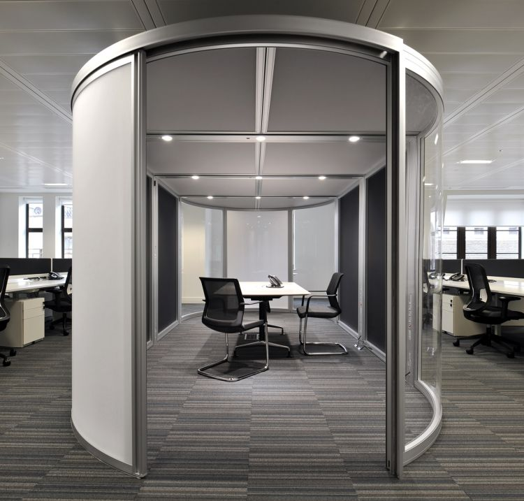 Private semi-circular modular meeting room space in an open plan office