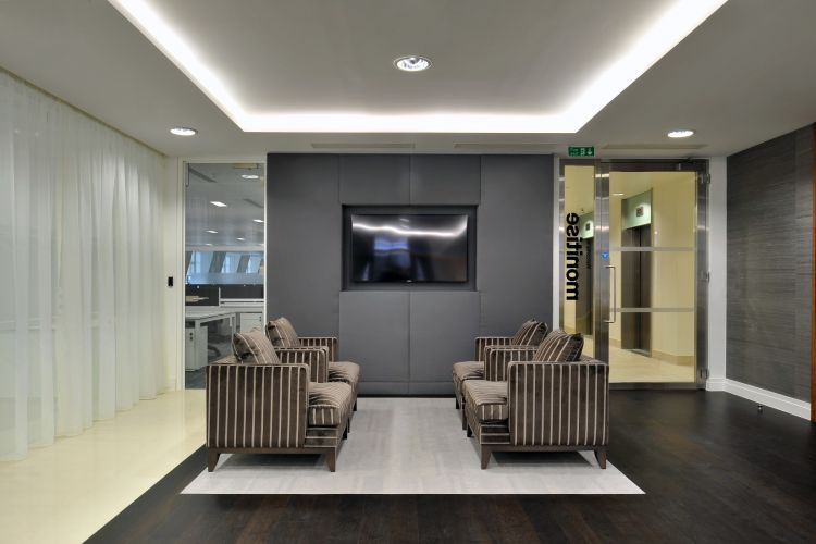 Soft lounges in corporate waiting area in designer office