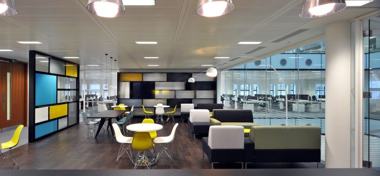 Staff breakout area with coloured walls and designer furniture in new office fit out