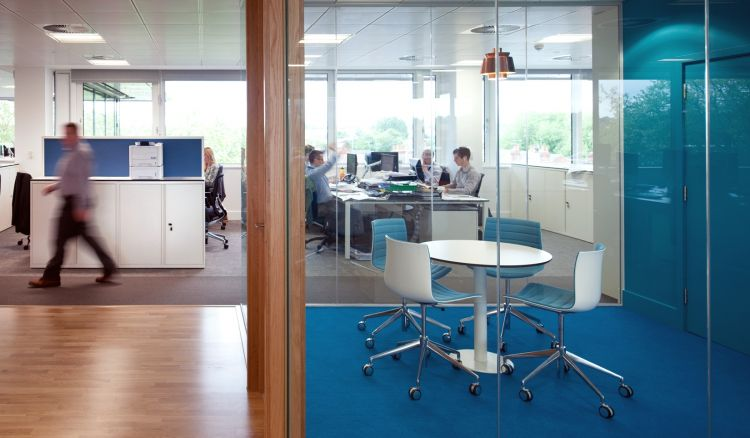 Blue themed meeting room in an open plan designer office fit out