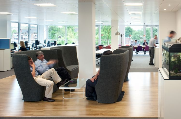 Pods of high-backed meeting pods in open plan office fit out