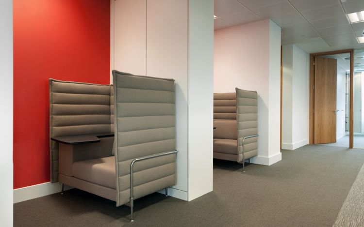 Private solo meeting and work chairs in modern office