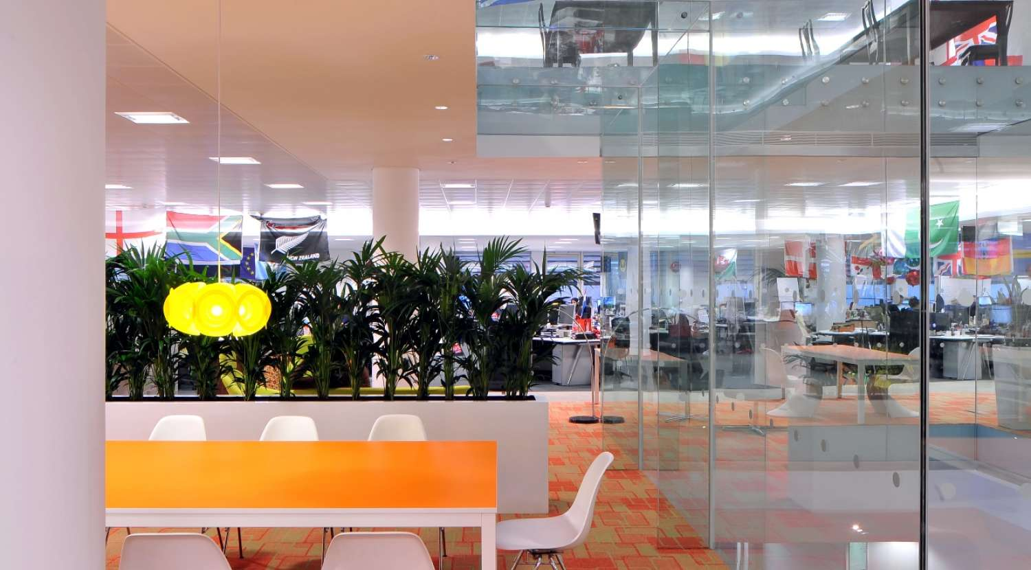 Meeting rooms broken up by indoor plants / Design and fit out by Morgan Lovell