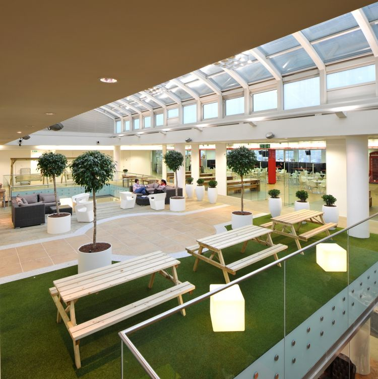 Summer-style patio meeting area with astro turf and picnic chairs / Design and fit out by Morgan Lovell